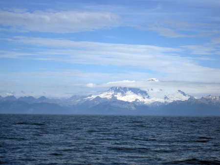 Beautiful snow capped Mount Illiama seem to rise out of Cook Inlet.  Mountain Range is Aleutian Range.