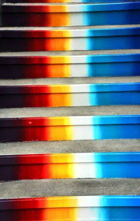 Concrete steps painted colors of the rainbow, climb heavenward.
