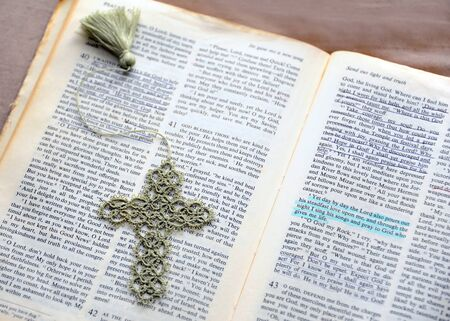 Hand crocheted bookmark lays on open Bible.  Underlined passages show encouragement and comfort.