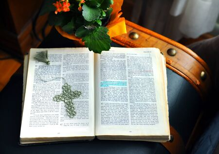 Bible lays across an old trunk.  Hand crocheted cross book mark lays on open page.  Highlight shows words of encouragement and hope.