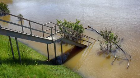 Viewing area at the Camden River Front Access on the Ouachita River is submerged under the rising river.  Excessive Springtime rain has river over its banks. Banco de Imagens