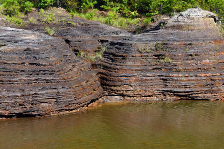Nicknamed the Arkansas Grand Canyon, at White Oak Lake State Park, unusual rock formation can be seen. Erosion from draining White Oak Lake, layers were formed in the rocky terrain.