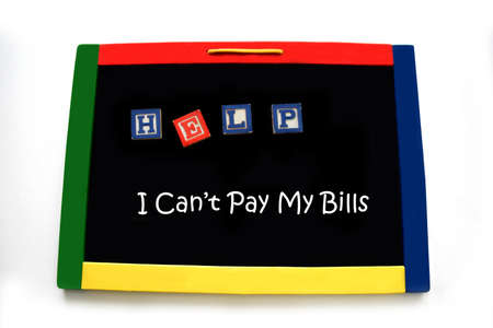Wooden block letters spell the word help on a magnetic board.  Below handwriting says I can't pay my bills.  Board is rimmed with primary colors.