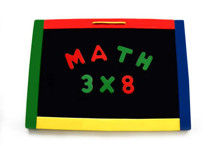 Wooden letters spell math and a multiplication problem on a magnetic board.  Board is rimmed with primary colors.