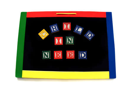 Wooden block letters spell the words child in need on a magnetic board.  Image could represent a hungry child, in need of protection or depression. 스톡 콘텐츠