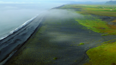 unearthly: Black volcanic sandy beach in Iceland