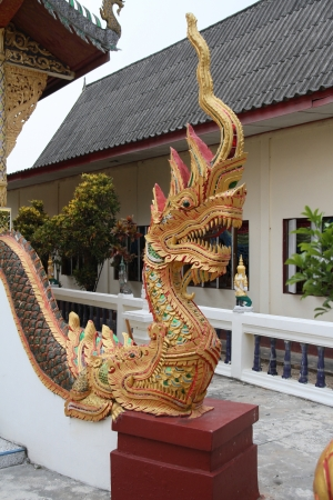 statue of nagas in front of buddhism temple Thailand Banco de Imagens