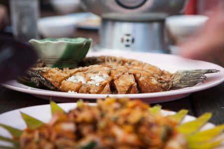 Fish fry in a plate on the table. Banco de Imagens - 83753394
