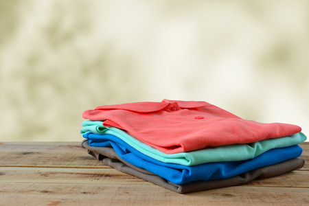 Stack of polo shirt.