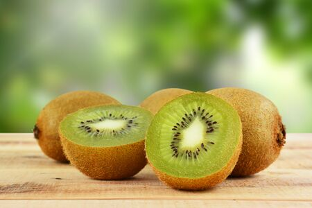 Kiwi fruit on wooden and blur background.