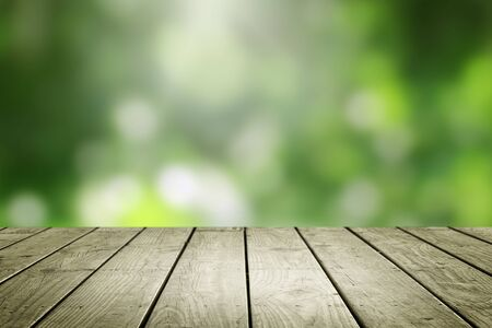 Empty wooden and blur green background.