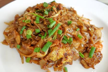 Asian stir-fried flat rice noodles photo