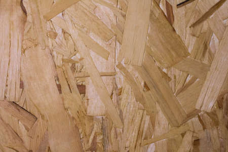 wooden natural rustic background. chipboard. Abstract texture plywood veneer. Sheet of plywood with fragments of compressed sawdust Imagens