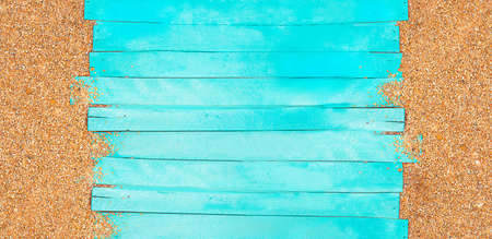 Marine banner. Turquoise horizontal wooden jetty planks with beach pebble sand. Travel and tourism. Copy space