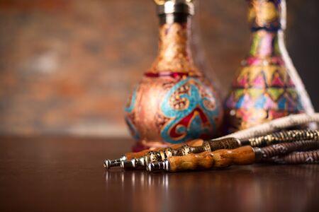 turkish ethnicity: Eastern hookahs on wood table