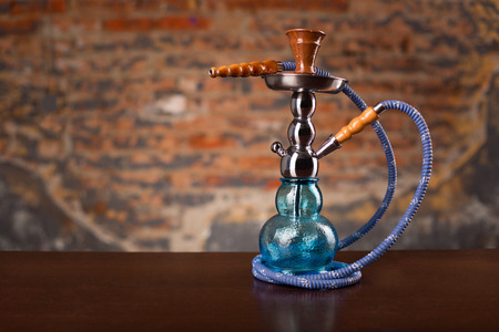 turkish ethnicity: Eastern hookah on wood table Stock Photo
