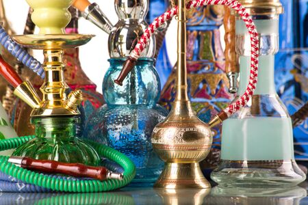 multiple ethnicities: Group of eastern hookahs on white background Stock Photo