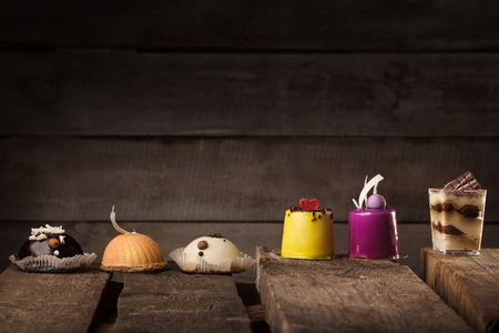 truncated: Many tasty cucpcake on the wooden table