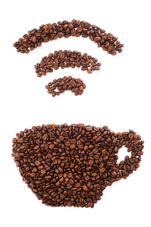 Cup with wi-fi shape made of coffee beans over white background Stock Photo