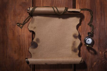 desperado: Old paper with watches on the wood background Stock Photo