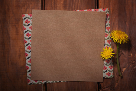 desperado: Old paper and card on the wood background