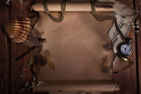 desperado: Old paper with watches on wooden background
