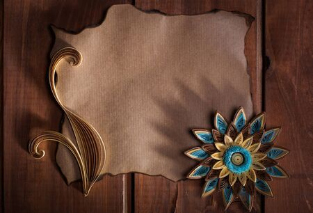 desperado: Old paper and quilling art on wooden background