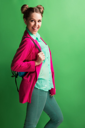 subculture: Portrait of a cheerful young girl in bright casual clothes smiling at the camera with beautiful smile.