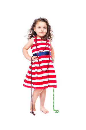 cute little girl in dress isolated on white