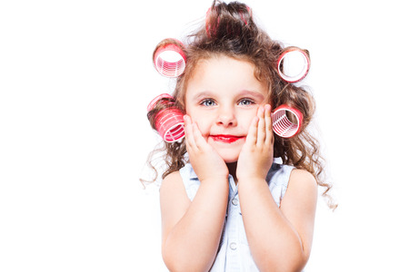 Adorable funny little girl making makeup with mother cosmetics Stock Photo