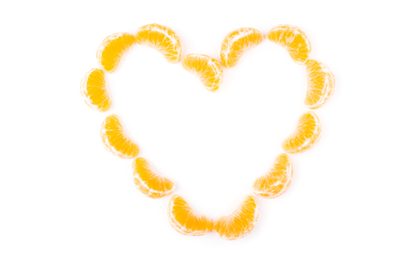Tangerines in a heart on white background