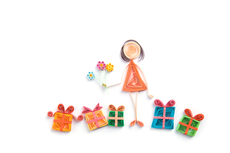 design objects: Quilling. Ribbon woman and gifts  on a light background