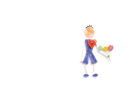 Quilling. Ribbon man with flowers on a light background