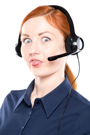 Portrait of happy smiling cheerful support phone operator in headset. Make funny face. Isolated on white background