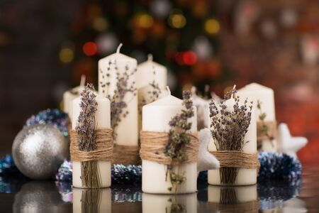 beeswax candle: Christmas candles with dry lavender on glass table