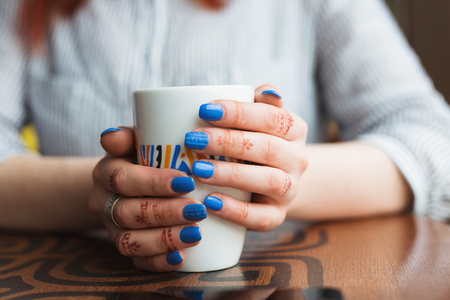 woman hands with coffe on a wood table. Stock Photo