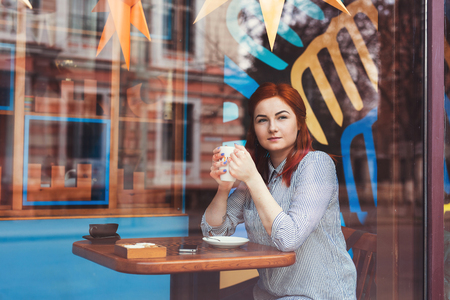 Young Attractive Woman in Cafe. Stock Photo