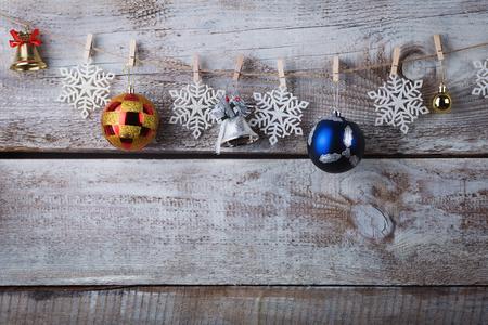 chrismas decorations hanging on rope on wooden background. Reklamní fotografie