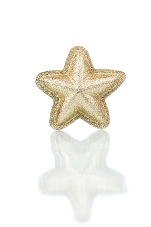star ornament: Gold Christmas star isolated over a white background. Stock Photo