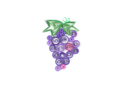 quilling: grape over made with quilling technique on white background.
