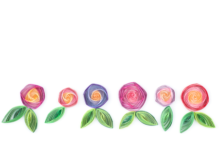quilling: flowers made quilling on a light background. Stock Photo