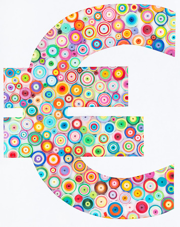 quilling: Concept of euro on colorful paper made with quilling technique on white background Stock Photo