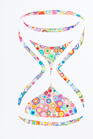 quilling: Concept of hourglass paper made with quilling technique on white background