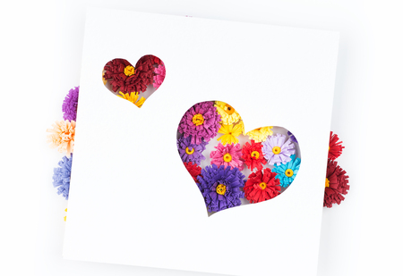 quilling: Small, colorful paper flowers made with quilling technique on white background Stock Photo