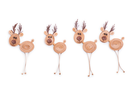 Creative paper reindeers on a white background. Quilling art