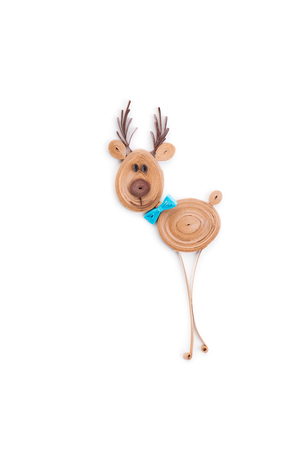 Creative paper reindeer on a white background. Quilling art