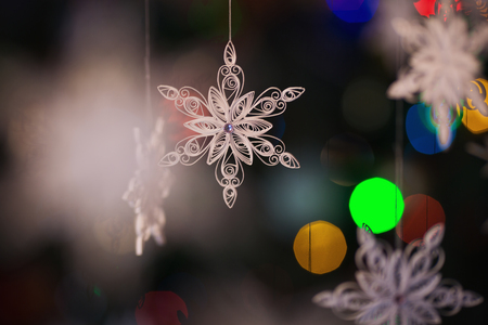 quilling: Paper snowflake made with quilling technique - macro details.