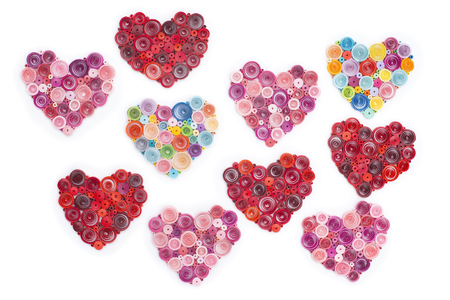Many hearts made in quilling art on white. Stock Photo