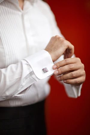 cuff link: Men preparing for wedding, clothes Stock Photo