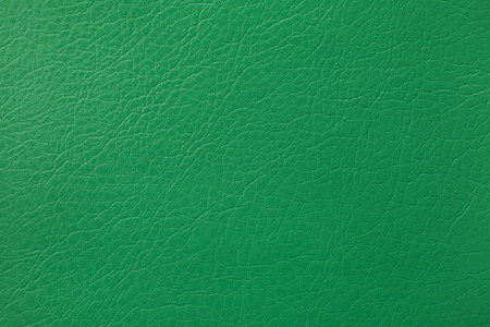 Green leather texture as background.